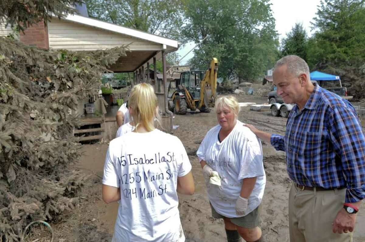 U.S. Sen. Chuck Schumer encourages Donna Wolbert and her daughters after touring their flood devastated home following last Sunday's Tropical Storm Irene, on Sunday Sept. 4, 2011, in Rotterdam Junction, NY. (Philip Kamrass / Times Union)
