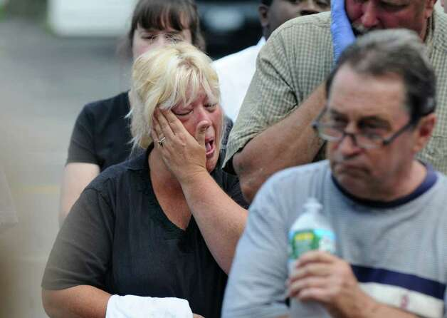 Donna Wolbert wipes away a tear while listening to U.S. Sen. Chuck Schumer at the Rotterdam Junction Volunteer Fire Department on Sunday Sept. 4, 2011 in Rotterdam Junction, NY. Her nearby home was devastated by floods following last Sunday's Tropical Storm Irene.  (Philip Kamrass / Times Union) Photo: Philip Kamrass / 00014510A