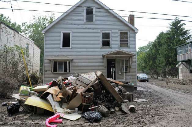 View of the devastation from Tropical Storm Irene on Isabella Street on Sunday Sept. 4, 2011 in Rotterdam Junction, NY.  (Philip Kamrass / Times Union) Photo: Philip Kamrass / 00014510A