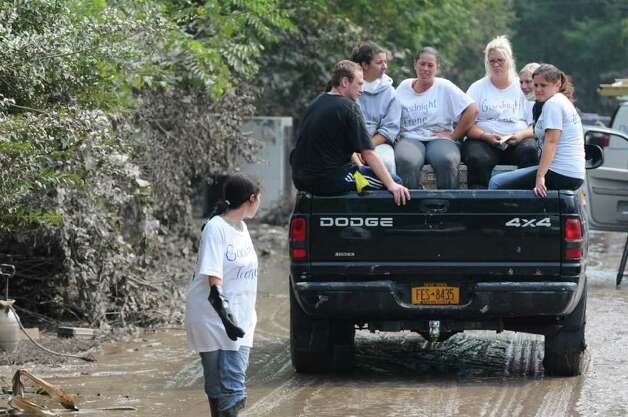 Members of the Wolbert family ride away from their mother's home, devastated by floodwaters from last Sunday's Tropical Storm Irene, on Sunday Sept. 4, 2011 in Rotterdam Junction, NY.  (Philip Kamrass / Times Union) Photo: Philip Kamrass / 00014510A