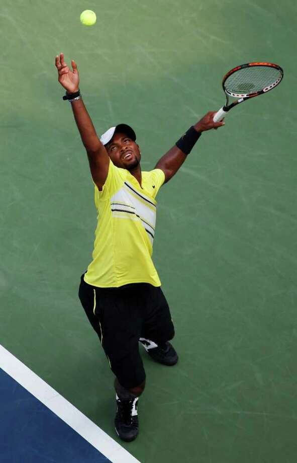 Donald Young serves to Juan Ignacio Chela of Argentina during the U.S. Open tennis tournament in New York, Sunday, Sept. 4, 2011. (AP Photo/Paul J. Bereswill) Photo: Paul J. Bereswill
