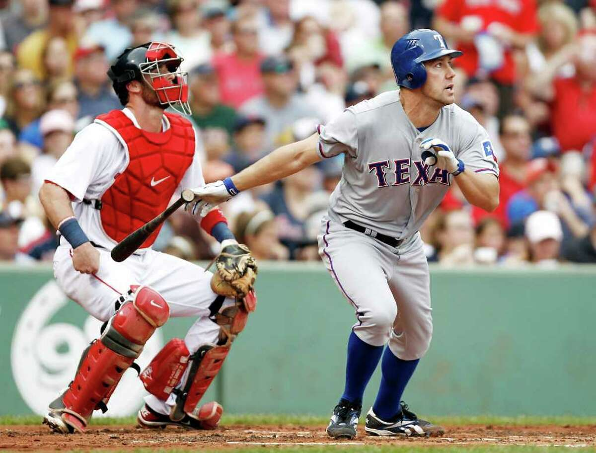 Texas Rangers' David Murphy and Boston Red Sox catcher Jarrod Saltalamacchia watch Murphy's triple during the second inning of a baseball game at Fenway Park in Boston Sunday, Sept. 4, 2011. (AP Photo/Winslow Townson)