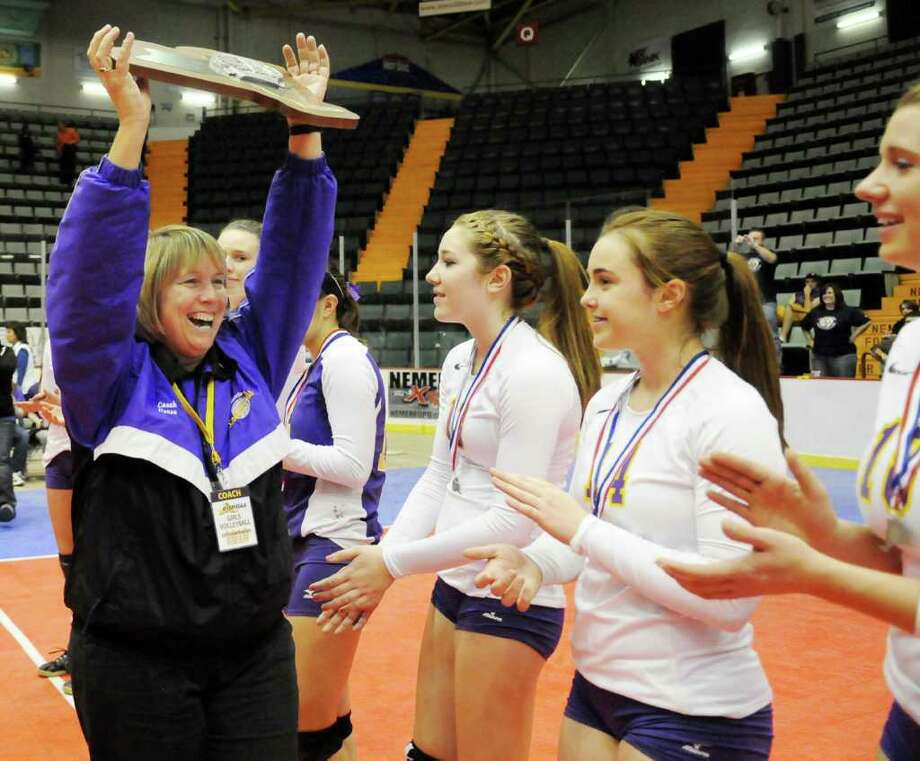 Head Coach Sandra Vorse, of the Voorheesville High School Blackbirds Girls Volleyball Team raises the runner up trophy to show her disappointed team that she is proud of them following their lost in the finals to the Falconer Central School Girls Volley Ball Team in the Class C State Final of the 2010 NYSPHSAA, Girls Volleyball Championships at the Glens Falls Civic Center, in Glens Falls, NY, on Sunday, Nov. 21, 2010.  Photos for Daily Sports Dept. High School coverage and for a Web Photo Gallery.     (Luanne M. Ferris / Times Union) Photo: Luanne M. Ferris / 00011142A