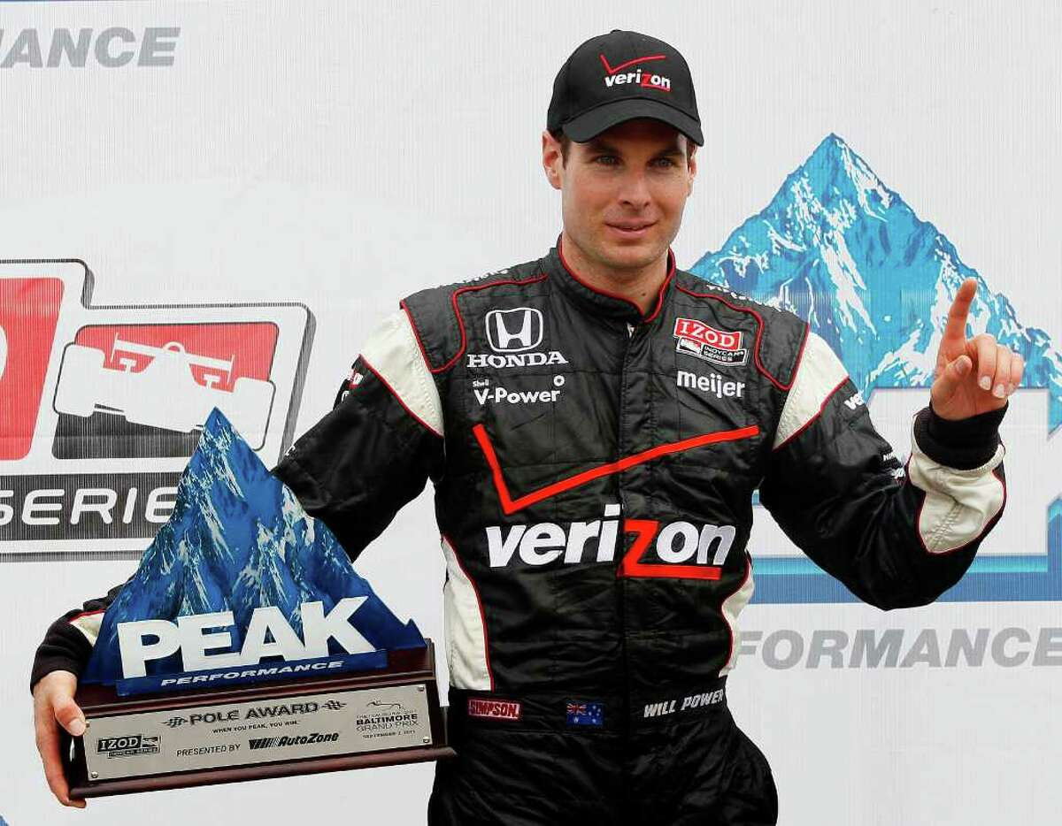 Will Power poses for a picture after taking the pole position in a qualifying round for the IndyCar Baltimore Grand Prix auto race on Saturday, Sept. 3, 2011, in Baltimore. (AP Photo/Patrick Semansky)