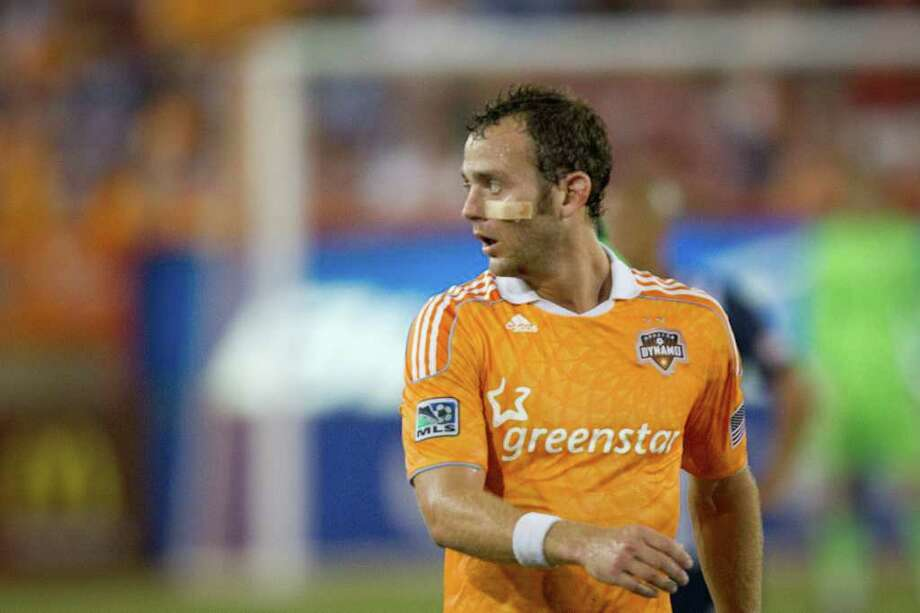 Dynamo midfielder Brad Davis returns to action with a bandage on his cheek after receiving medical attention. Photo: Smiley N. Pool, Houston Chronicle / © 2011  Houston Chronicle