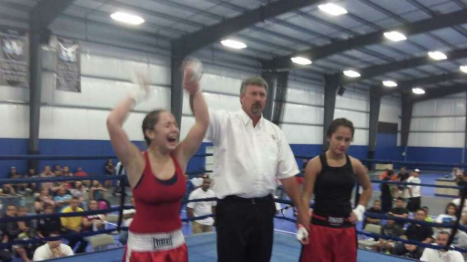 Celeste Wilson, left, outpointed Robianne Rivera for the female intermediate 119-pound championship. Photo: Peter Lim