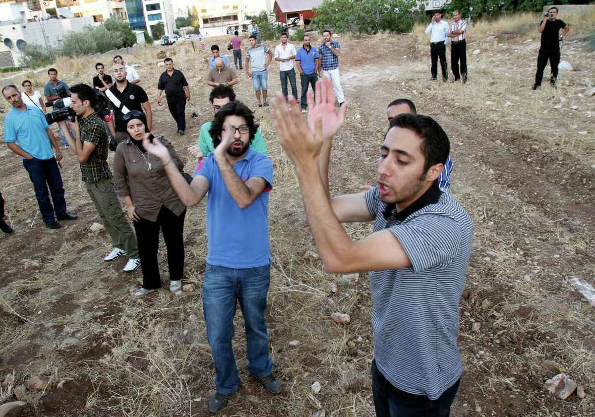 Jordanian protesters try to reach Bahrain's embassy in Amman, Jordan, Sunday, Sept. 4, 2011, to protest against the presence of foreign troops in Bahrain who reinforced Bahraini security forces during anti-government protests. (AP Photo/Raad Adayleh)
