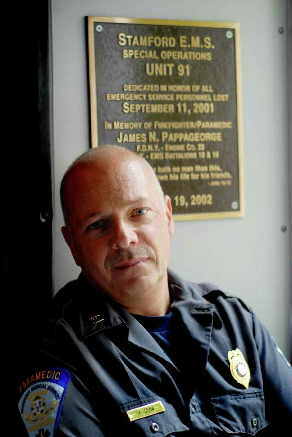 Capt. Malcom Dean is a Stamford, Conn. EMS paramedic who was working as a New York City ambulance corps and responded to the World Trade Center on September 11, 2001. His brother worked on one of the top floors of one of the Twin Towers, and while Dean was able to escape from the tower collapse, his brother died. Dean is photographed on Monday September 5, 2011.