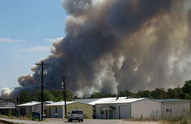 Fires burn near Bastrop, Texas Monday September 5, 2011. JOHN DAVENPORT/jdavenport@express-news.net Photo: JOHN DAVENPORT/jdavenport@express-news.net