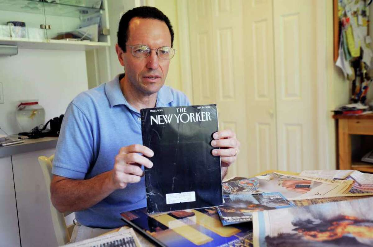 Dr. Tony Dajer works at the emergency room at the New York Downtown Hospital in New York City and he worked on 9/11. He has a large collection of newspapers and magazines concerning 9/11. He holds The New Yorker cover on Monday, Sept. 5, 2011, depicting the twin towers in the dark.