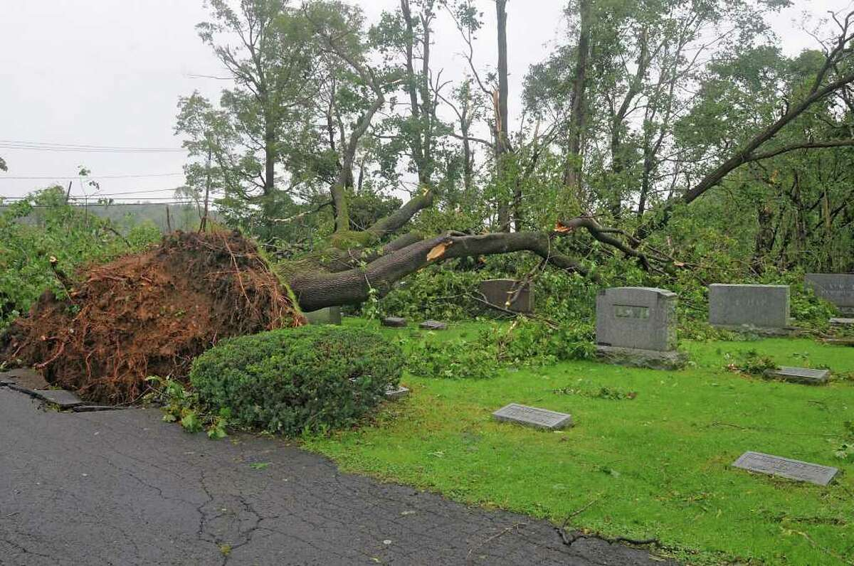 Trees are uprooted in the Temple of Israel Cemetery Monday, Sept. 5, 2011 due to a tornado that touched down in Amsterdam, N.Y. on Sunday. (Lori Van Buren / Times Union)