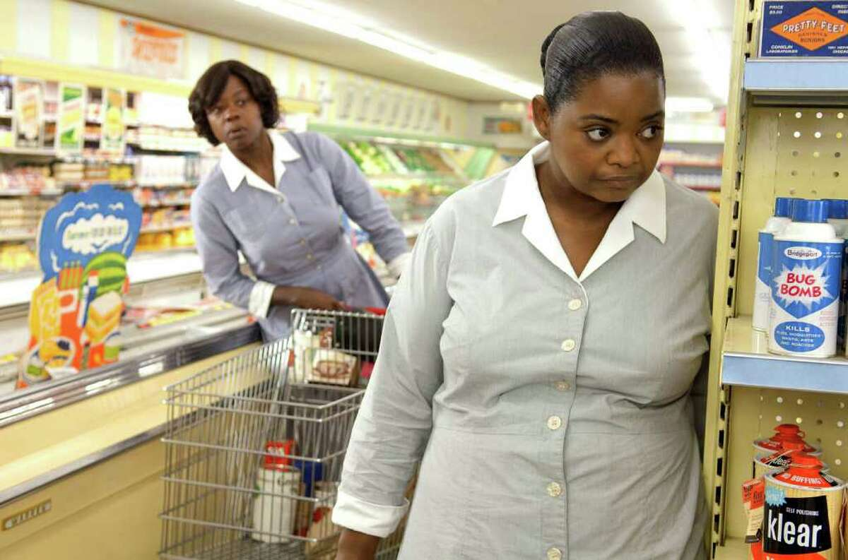 """FILE - In this file film publicity image provided by Disney, Octavia Spencer, right, and Viola Davis are shown in a scene from """"The Help."""" """"The Help"""" has stayed on the job over Labor Day, finishing as the No. 1 film for the third-straight weekend. According to studio estimates Monday, Sept. 5, 2011, the acclaimed drama about Southern black maids took in $19 million over the long holiday weekend. (AP Photo/Disney, Dale Robinette, File)"""
