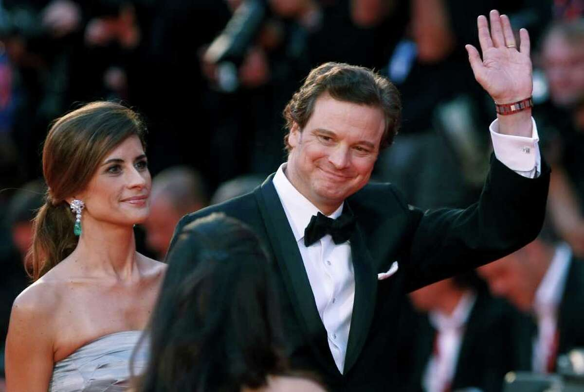 Actor Colin Firth, right, and Livia Giuggioli arrive for the premiere of the movie Tinker, Tailor, Soldier, Spy, at the 68th edition of the Venice Film Festival in Venice, Italy, Monday, Sept. 5, 2011. (AP Photo/Andrew Medichini)
