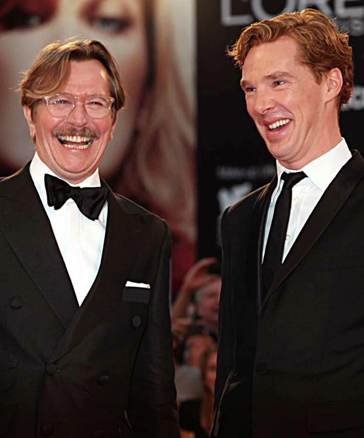 British actors Gary Oldman, left, and Benedict Cumberbatch share a joke as they arrive for the premiere of the film Tinker Tailor Soldier Spy at the 68th edition of the Venice Film Festival in Venice, Italy, Monday, Sept. 5, 2011. (AP Photo/Joel Ryan)