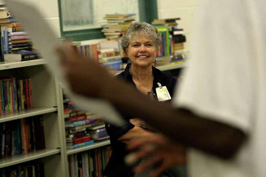 KAREN WARREN : CHRONICLE AN ANGEL'S SMILE: Marilu Ballow enjoys a presentation by one of her students in the library at the Burnett-Bayland Reception Center. Photo: Karen Warren, Staff / © 2011 Houston Chronicle