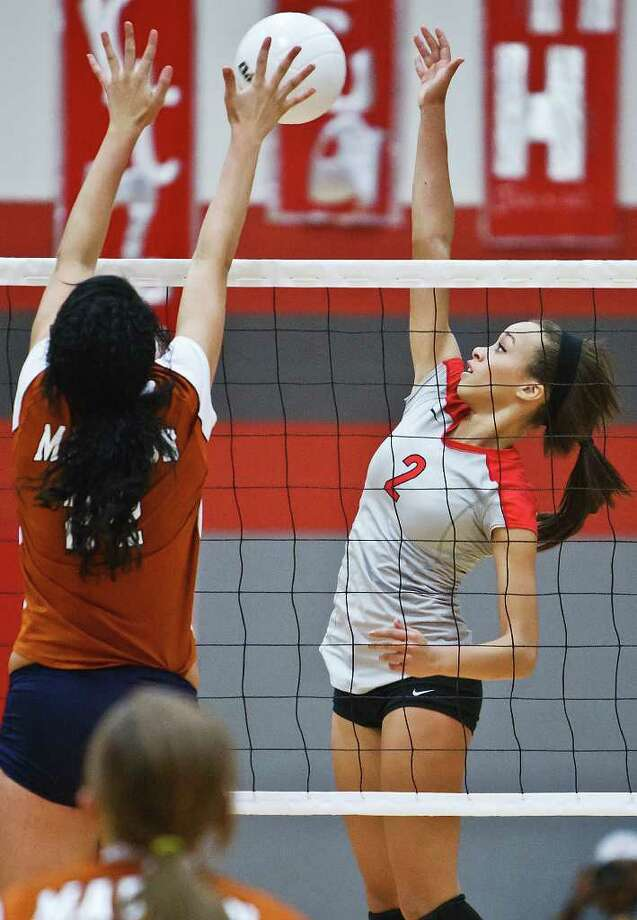 Judson's Krystal Faison — seen here playing Madison on Aug. 23 — had 16 kills, 14 digs and three aces in a win against Roosevelt, and 31 kills in a triumph against Harlandale. Photo: Marvin Pfeiffer/mpfeiffer@primetimenewspapers.com