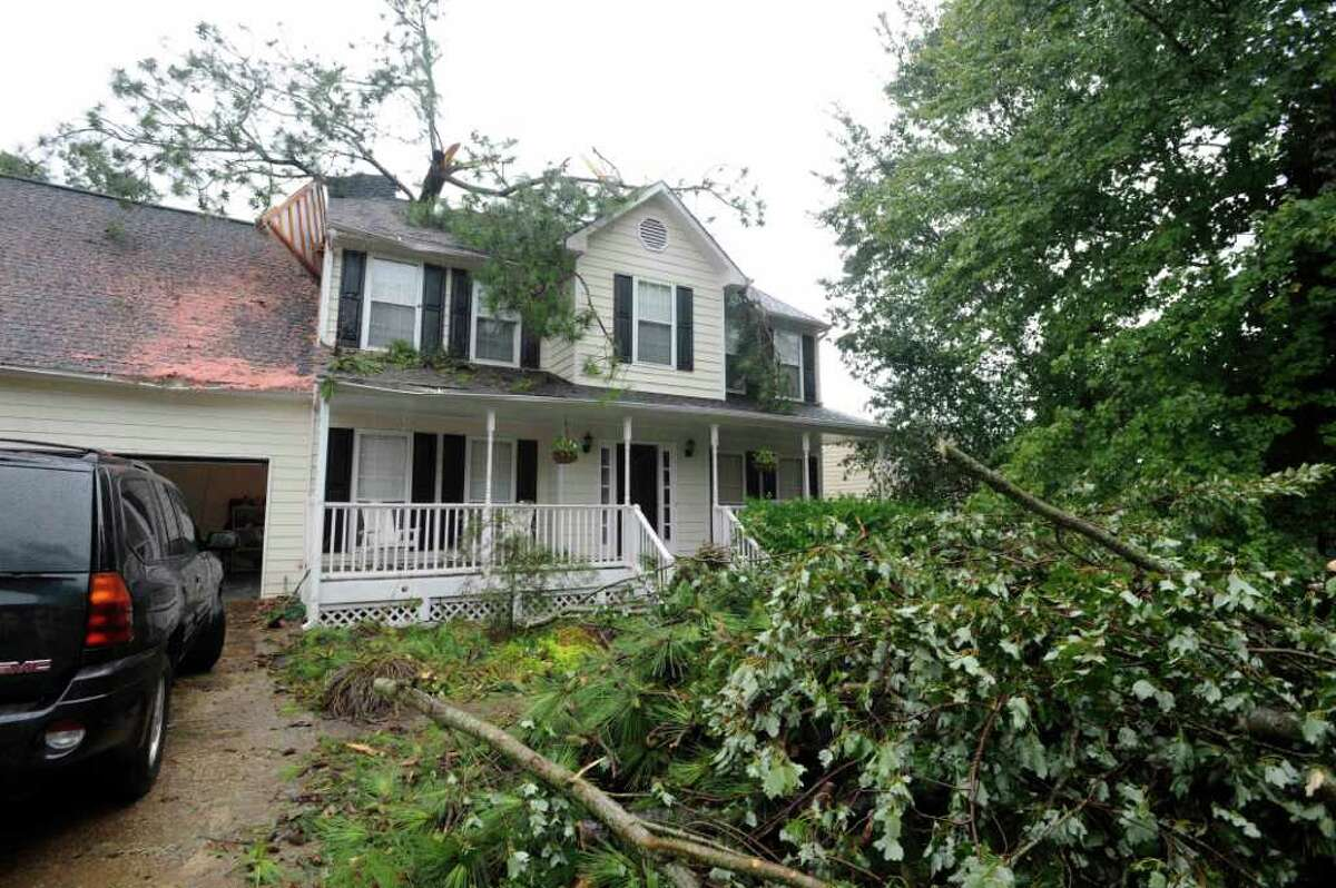 The home of Bob Van Derwart is shown after a possible tornado moved through the area leaving a Pine tree in his home, Monday, Sept. 5, 2011, near Woodstock, Ga. One person was injured in a possible tornado in Cherokee County as the remnants of Tropical Storm Lee crossed the state Monday afternoon, authorities said. Lt. Jay Baker with the Cherokee County Sheriff's department said the storm toppled trees, snapped power lines and damaged homes near Woodstock. He said the victim was taken to the hospital but the person's condition was not known. (AP Photo/Mike Stewart)