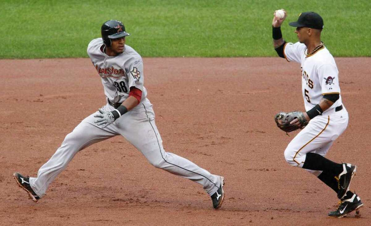 Houston Astros' Jimmy Paredes (38) is caught in a rundown between second and third by Pittsburgh Pirates shortstop Ronny Cedeno during the ninth inning of a baseball game in Pittsburgh, Monday, Sept. 5, 2011. Paredes was tagged out and Astros' Matt Downs advanced to second on the fielder's choice. The Pirates won 3-1.
