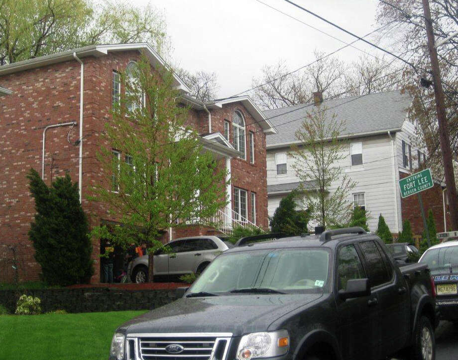 This April 2011 photo provided by the Office of the Special Narcotics Prosecutor for the City of New York shows the exterior of a home in Fort Lee, N.J., where heroin was packaged. Narcotics investigators who shut down the heroin mill earlier this year and others like it say they represent the new, more serene face of the still-thriving heroin trade in the New York City area, for decades the drug's national epicenter. (AP Photo/Office of the Special Narcotics Prosecutor for the City of New York)