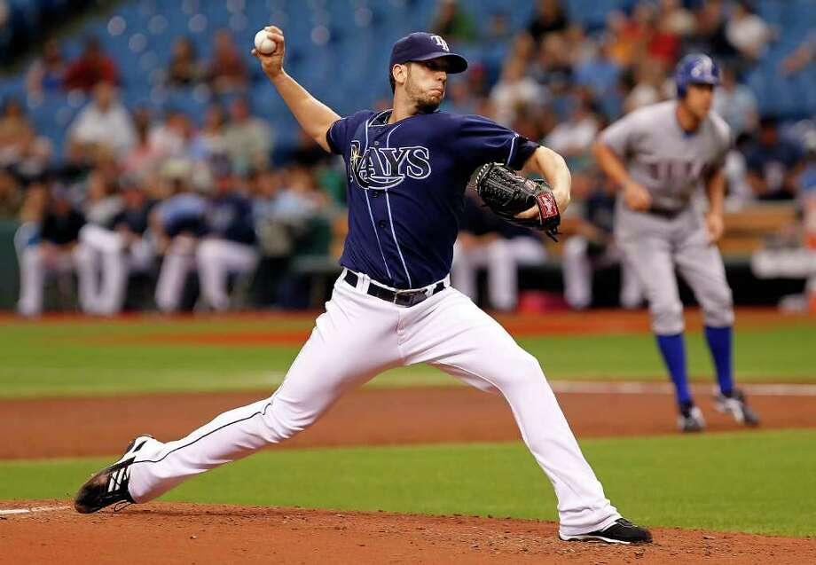 J. MERIC: GETTY IMAGES COMPLETE PACKAGE: The Rays' James Shields went the distance for a major league-leading 11th time this season Monday against the Rangers. Photo: J. Meric, Stringer / 2011 Getty Images