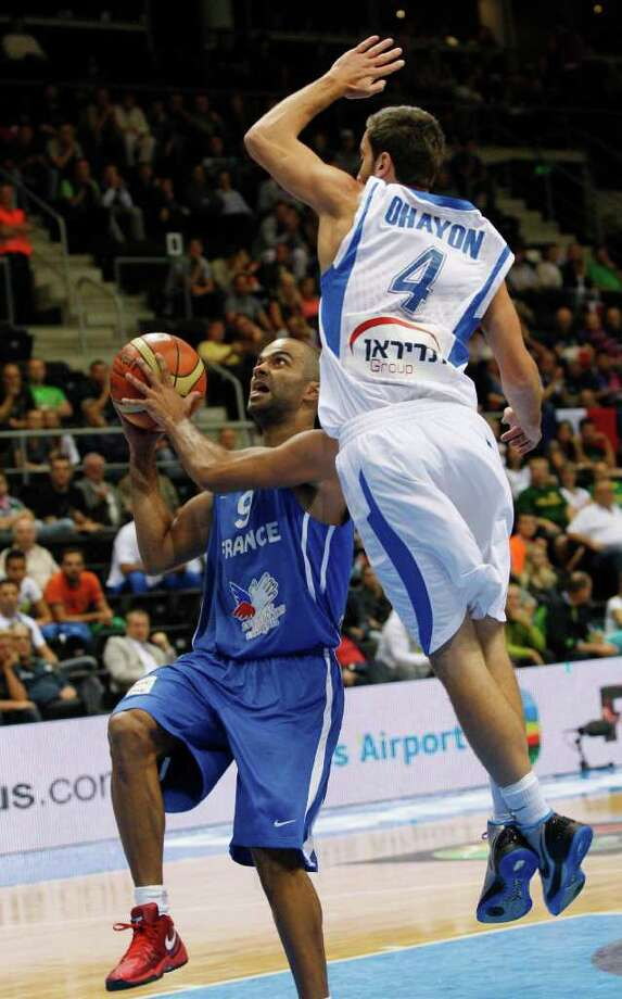 Tony Parker, left, from France is guarded by Yogev Ohayon, right, from Israel during the EuroBasket European Basketball Championship Group B match in Siauliai, Lithuania, Thursday, Sept. 1, 2011. Photo: Petr David Josek/Associated Press / AP