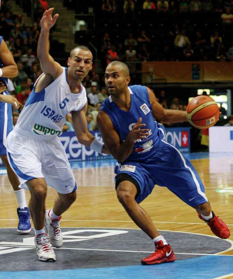 Tony Parker, right, from France is guarded by Afik Nissim, left, from Israel during the EuroBasket European Basketball Championship Group B match in Siauliai, Lithuania, Thursday, Sept. 1, 2011. Photo: Petr David Josek/Associated Press / AP