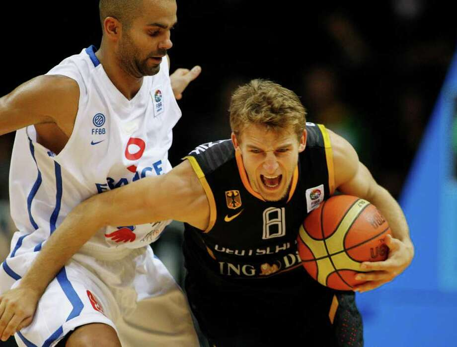 Tony Parker, left, from France fouls Heiko Schaffartzik, right, from germany during the EuroBasket European Basketball Championship Group B match in Siauliai, Lithuania, Friday, Sept. 2, 2011. France won the match 76-65. Photo: Petr David Josek/Associated Press / AP