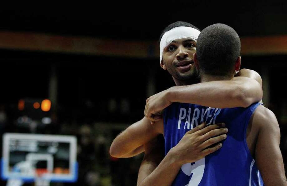 Nicolas Batum, left, from France celebrates with his teammate Tony Parker, right, after defeating Serbia in the EuroBasket European Basketball Championship Group B match in Siauliai, Lithuania, Monday, Sept. 5, 2011. France won the match 97-96. Photo: Petr David Josek/Associated Press / AP