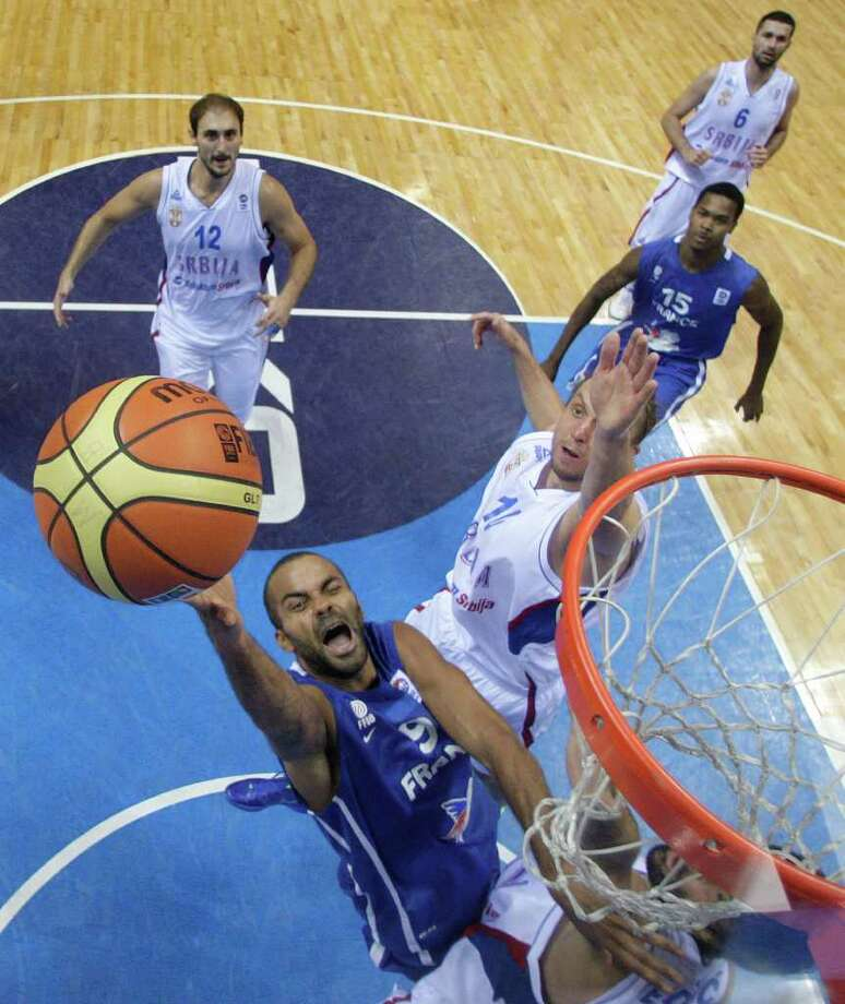 Dusko Savanovic, right, from Serbia challenges Tony Parker, left, from France during the EuroBasket European Basketball Championship Group B match in Siauliai, Lithuania, Monday, Sept. 5, 2011. France won the match 97-96. Photo: Petr David Josek/Associated Press / AP