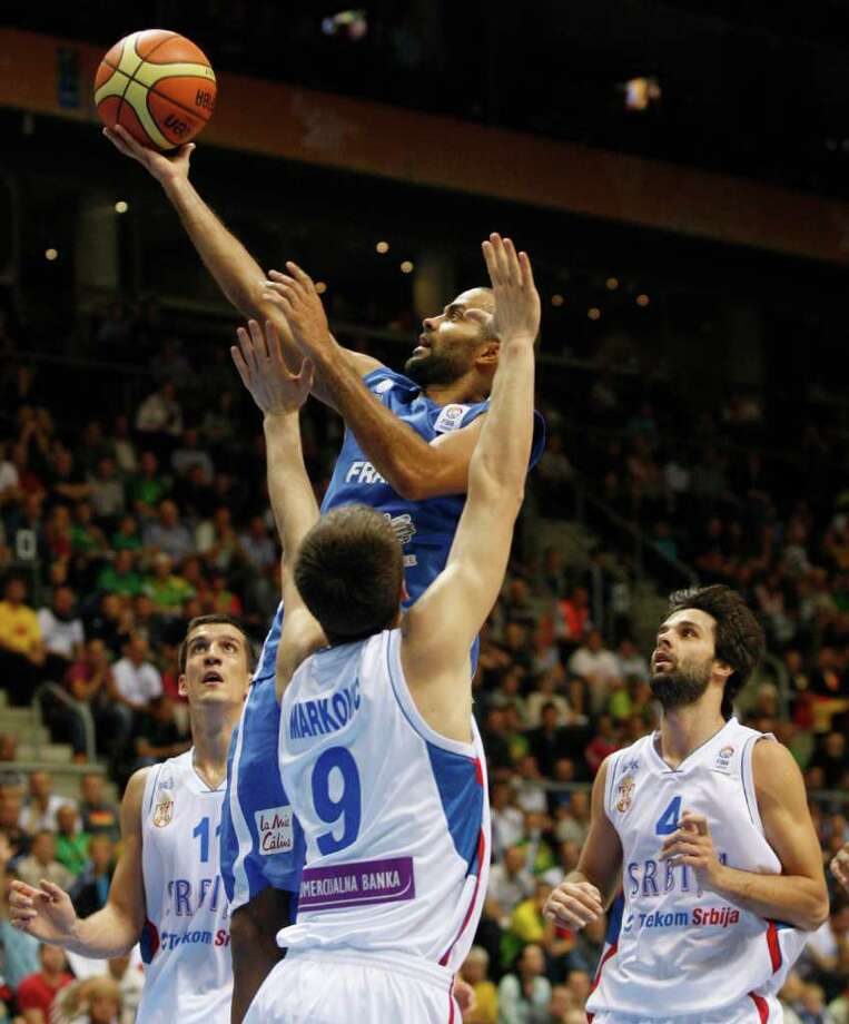 Stefan Markovic, down, from Serbia tries to block Tony Parker, top, from France during the EuroBasket European Basketball Championship Group B match in Siauliai, Lithuania, Monday, Sept. 5, 2011. Photo: Petr David Josek/Associated Press / AP