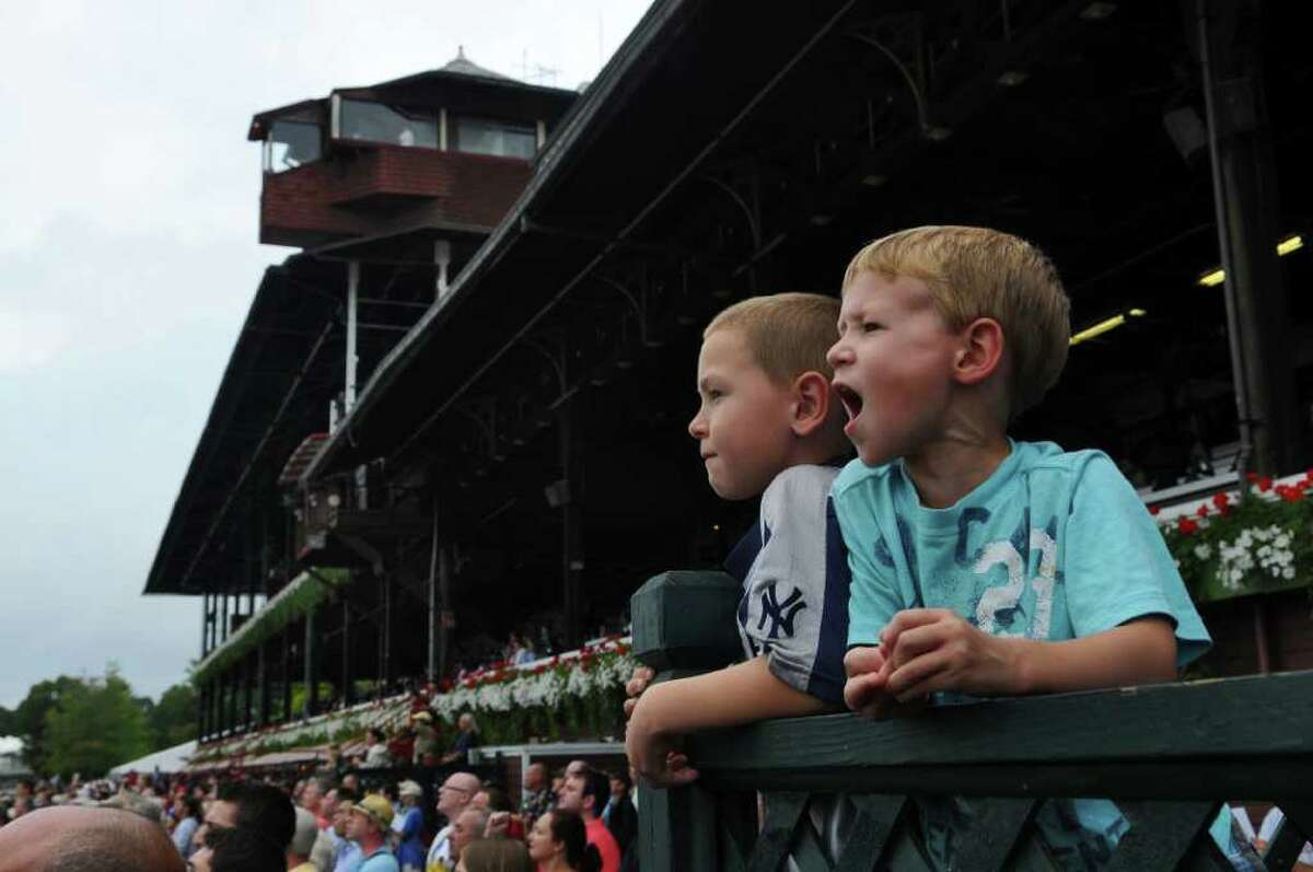 Noah Hilleboe, 4, right, and his brother Zachary, 7, left, of South Glens Falls, cheer their horse during the 6th race on the last day of racing at Saratoga Race Course on Monday Sept. 5, 2011 in Saratoga Springs, NY. Noah's picked a winner, with his horse, T.J.'s Bodylan, with Cornelio Velasquez aboard, came in third. (Philip Kamrass / Times Union)