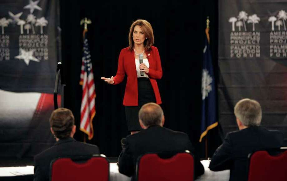 Republican presidential candidate Rep. Michele Bachmann, R-Minn., speaks at the American Principles Project Palmetto Freedom Forum Monday Sept. 5, 2011, in Columbia, S.C. (AP Photo/ Mary Ann Chastain) Photo: Mary Ann Chastain
