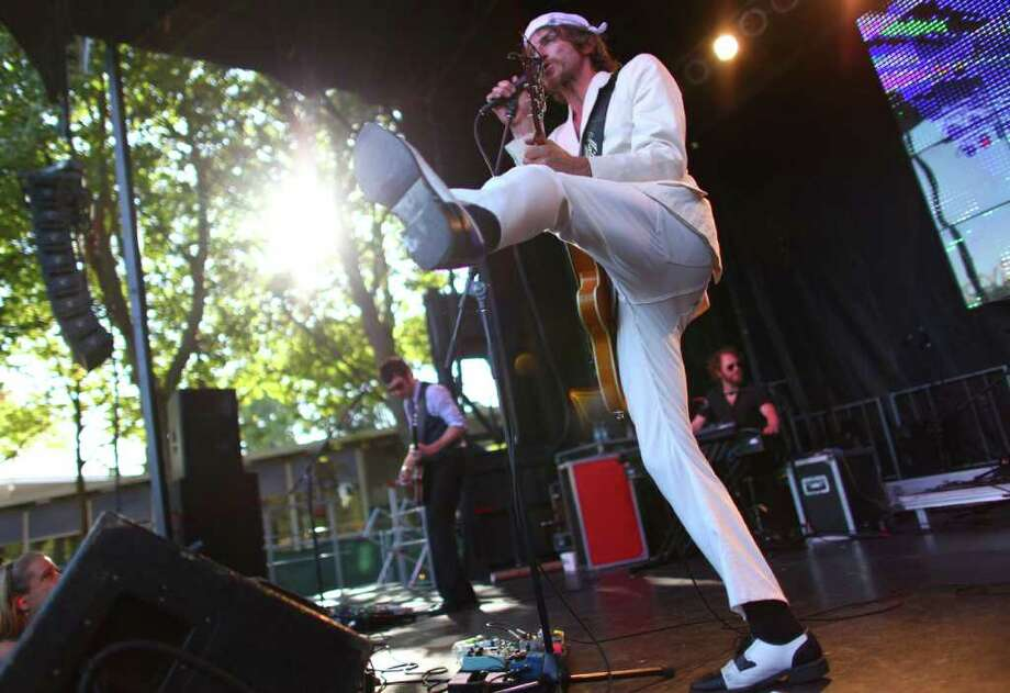 Tim Rogers with Australian rock band You I Am kicks up his foot during a performance on the Fountain Lawn Stage. Photo: JOSHUA TRUJILLO / SEATTLEPI.COM