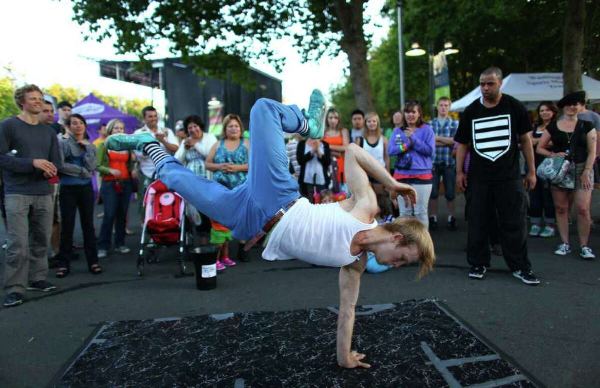 Bobby Bonsey performs break dancing with the Master Blaster crew on day three of Bumbershoot at the Seattle Center.