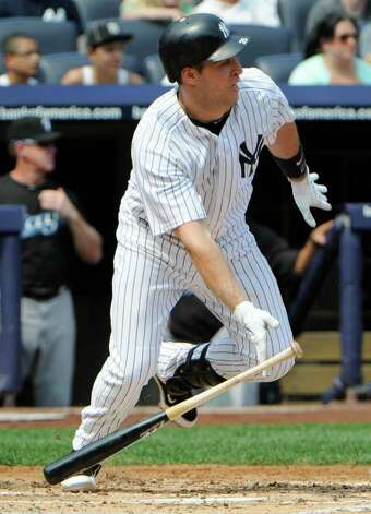 New York Yankees' Mark Teixeira hits an infield-single during the first inning of a baseball game against the Toronto Blue Jays, Sunday, Sept. 4, 2011, at Yankee Stadium in New York. The Yankees won 9-3.  (AP Photo/Bill Kostroun) Photo: Bill Kostroun, AP / FR51951 AP