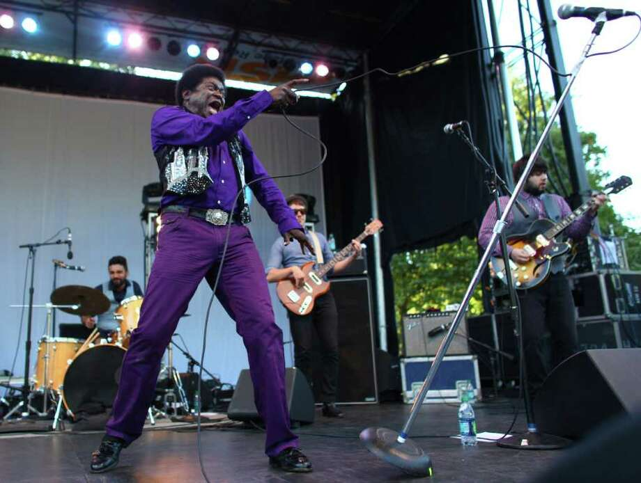 Charles Bradley tosses his mic stand during a performance on the Fischer Green Stage. Photo: JOSHUA TRUJILLO / SEATTLEPI.COM