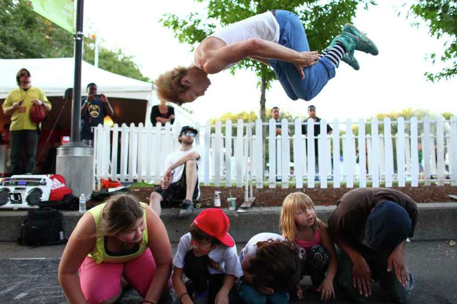 Bobby Bonsey with the Master Blaster crew leaps over audience members during a break dancing performance. Photo: JOSHUA TRUJILLO / SEATTLEPI.COM