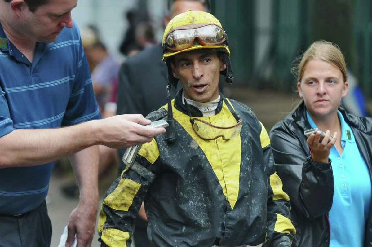 Jockey John Velazquez is interviewed as he walks back to the locker room after the 6th race at the Saratoga Race Course on Monday Sept. 5, 2011 in Saratoga Springs, NY. (Philip Kamrass / Times Union)