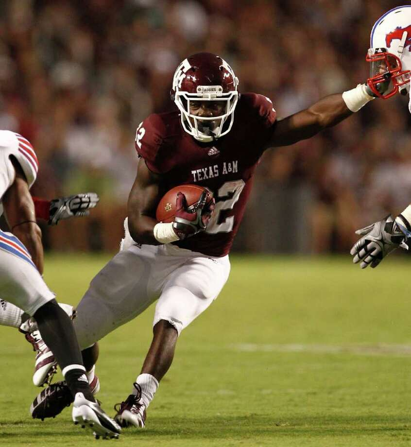 Texas A&M running back Cyrus Gray (32) looks for running room in the Southern Methodist defense in the second quarter of a NCAA football game, Sunday, Sept. 4, 2011, in Kyle Field in College Station. ( Nick de la Torre / Houston Chronicle ) Photo: Nick De La Torre, Staff / © 2011 Houston Chronicle