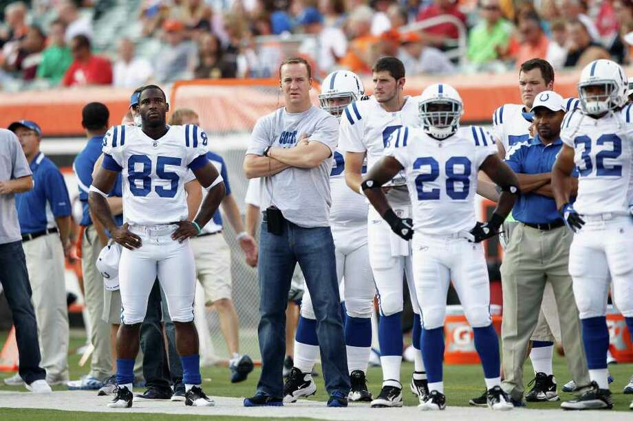 Colts quarterback Peyton Manning, center, likely won't play Sunday against the Texans. Photo: Joe Robbins, Getty / 2011 Getty Images