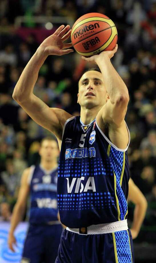 Argentina's Manu Ginobili, shoots to score during a FIBA Americas Championship basketball game against Paraguay in Mar del Plata, Argentina, Tuesday, Aug. 30, 2011. The top two finishers of the tournament get an automatic berth in the 2012 London Olympics and the next three advance to the last-chance Olympic qualifying tournament to be held in July 2012. Photo: Martin Mejia/Associated Press