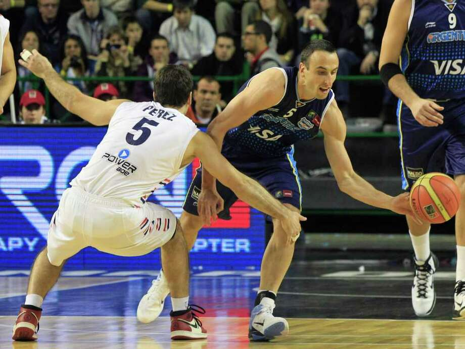 Argentina's Manu Ginobili, right, dribbles past Paraguay's Daniel Perez during a FIBA Americas Championship basketball game in Mar del Plata, Argentina, Tuesday, Aug. 30, 2011. The top two finishers of the tournament get an automatic berth in the 2012 London Olympics and the next three advance to the last-chance Olympic qualifying tournament to be held in July 2012. Photo: Martin Mejia/Associated Press