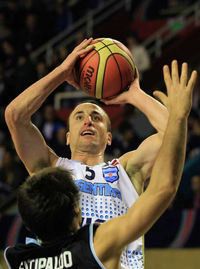 Argentina's Manu Ginobili shoots over Uruguay's Bruno Fitipaldo during a FIBA Americas Championship basketball game in Mar del Plata, Argentina, Wednesday Aug. 31, 2011. The top two finishers of the tournament get an automatic berth in the 2012 London Olympics and the next three advance to the last-chance Olympic qualifier to be held in July 2012. Photo: Martin Mejia/Associated Press