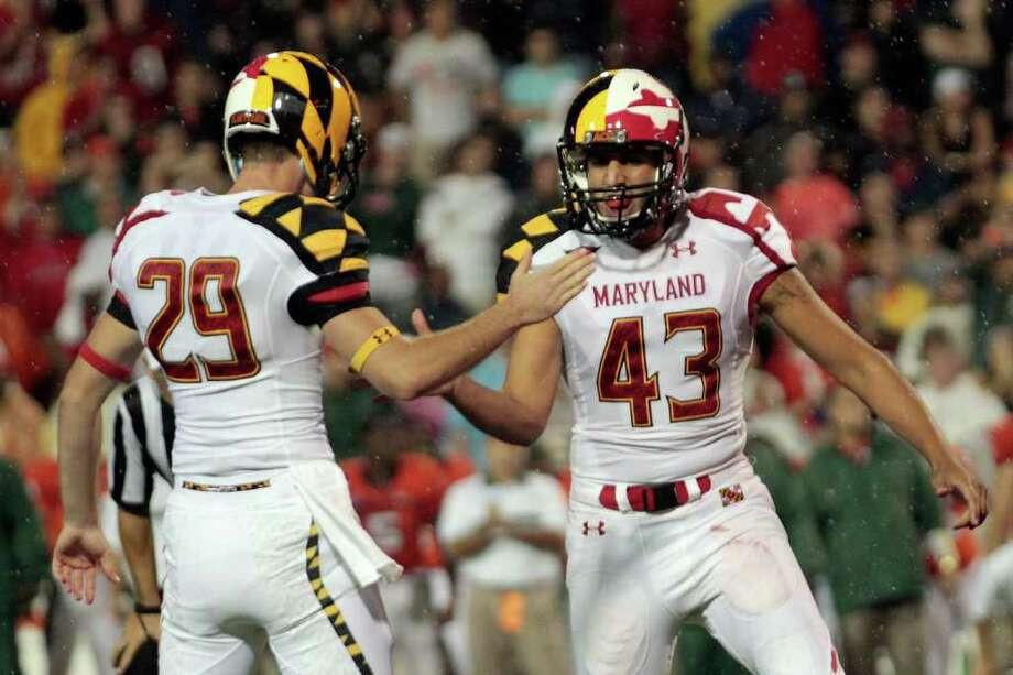 COLLEGE PARK, MD - SEPTEMBER 05: Holder Michael Tart #29 celebrates a late fourth quarter field goal with kicker Nick Ferrara #43 of the Maryland Terrapins against the Miami Hurricanes at Byrd Stadium on September 5, 2011 in College Park, Maryland. Maryland won 32-24. Photo: Rob Carr, Getty / 2011 Getty Images