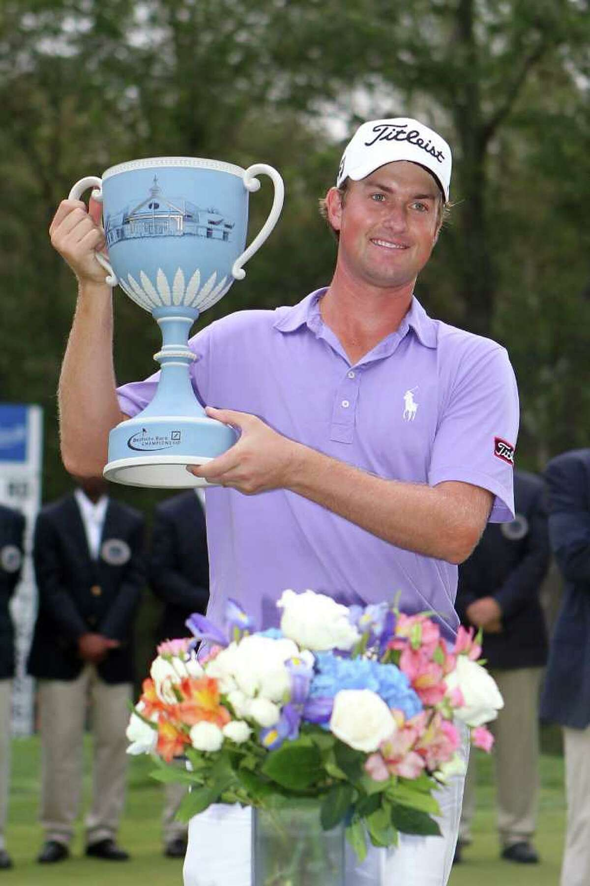 NORTON, MA - SEPTEMBER 05: Webb Simpson poses with the trophy after he won thr tournament following the final round of the Deutsche Bank Championship at TPC Boston on September 5, 2011 in Norton, Massachusetts. (Photo by Jim Rogash/Getty Images)