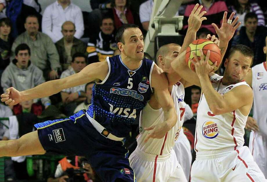 Argentina's Manu Ginobili, left, clashes with Puerto Rico's Carlos Arroyo, center, as Puerto Rico's Jose Juan Barea, right, grabs a rebound during a FIBA Americas Championship basketball game in Mar del Plata, Argentina, Friday Sept. 2, 2011. The top two finishers of the tournament get an automatic berth in the 2012 London Olympics and the next three advance to the last-chance Olympic qualifier to be held in July 2012. Photo: Martin Mejia/Associated Press