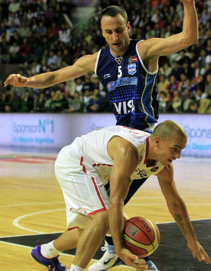 Argentina's Manu Ginobili, top, guards Puerto Rico's Carlos Arroyo during a FIBA Americas Championship basketball game in Mar del Plata, Argentina, Friday Sept. 2, 2011. The top two finishers of the tournament get an automatic berth in the 2012 London Olympics and the next three advance to the last-chance Olympic qualifier to be held in July 2012. Photo: Martin Mejia/Associated Press
