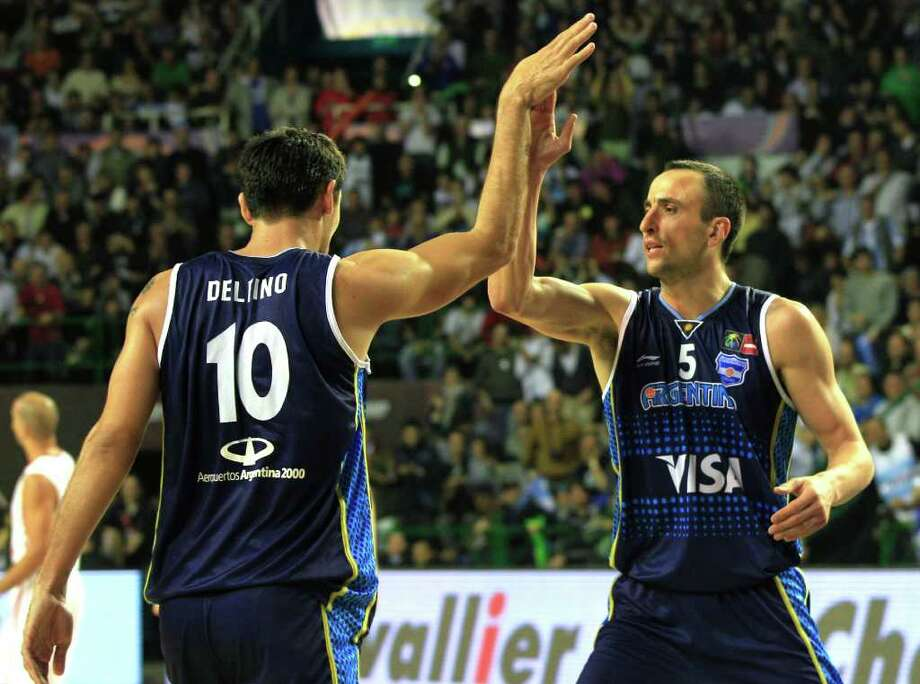 Argentina's Manu Ginobili, right, high fives teammate Carlos Delfino during a FIBA Americas Championship basketball game against Puerto Rico in Mar del Plata, Argentina, Friday Sept. 2, 2011. The top two finishers of the tournament get an automatic berth in the 2012 London Olympics and the next three advance to the last-chance Olympic qualifier to be held in July 2012. Photo: Martin Mejia/Associated Press