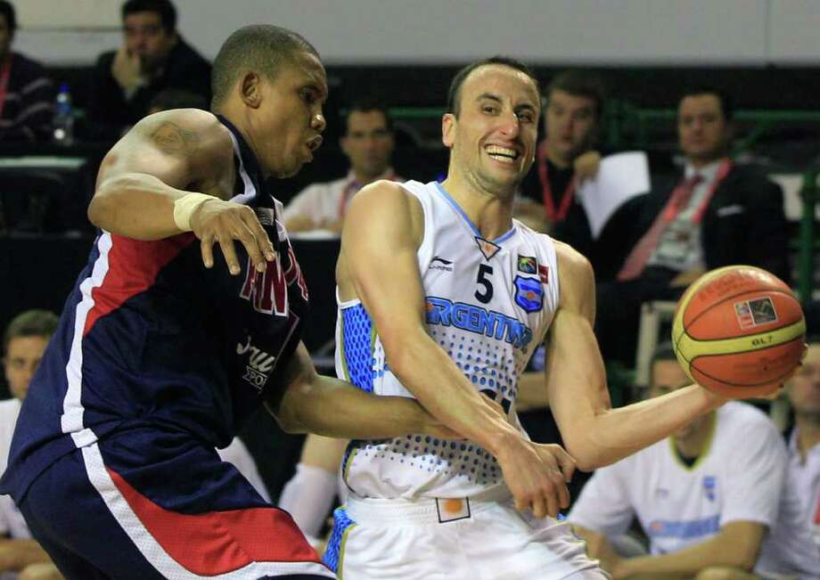 Argentina's Manu Ginobili, right, drives the ball against Panama's Jaime LLoreda during a FIBA Americas Championship basketball game in Mar del Plata, Argentina, Saturday, Sept. 3, 2011. The top two finishers of the tournament get an automatic berth in the 2012 London Olympics and the next three advance to the last-chance Olympic qualifier to be held in July 2012. Photo: Martin Mejia/Associated Press