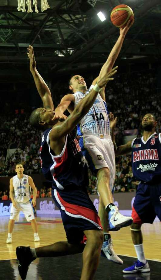 Argentina's Manu Ginobili, right, goes to the basket over Panama's Jaime LLoreda during a FIBA Americas Championship basketball game in Mar del Plata, Argentina, Saturday Sept. 3, 2011. The top two finishers of the tournament get an automatic berth in the 2012 London Olympics and the next three advance to the last-chance Olympic qualifier to be held in July 2012. Photo: Martin Mejia/Associated Press